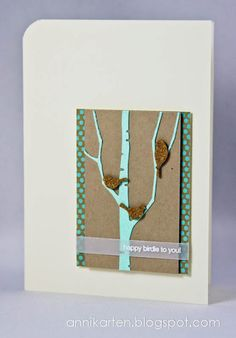 handmade card ... luv the Memory Box die cut birch tree in aqua with resting birds cut from cordk ... veluum band with embossed sentiment ... great card!!