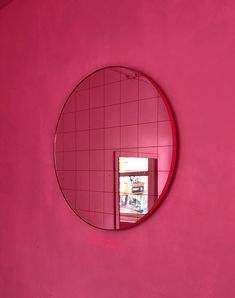 Delightful crafted silver round mirror with an elegant red frame and red grid.  Ideal above a console table in the hallway, above a beautiful fireplace, in the bedroom or in the bathroom.  Design tip: looks stunning used as a cluster in different sizes and/or colours.  Framed mirror available in 50cm, 60cm, 80cm & 100cm  (depth 18mm).