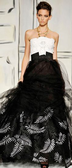 Oscar de la  Renta.  I should have been a movie star so I could wear these ridiculously beautiful gowns.