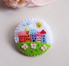 teeny brooch/button..
