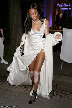The supermodel, put on a very leggy display while making a glamorous departure from Ralph & Russo's spring/summer 2020 presentation at Paris Haute Couture Fashion Week on Monday. Winnie Harlow, Silk Gown, Haute Couture Fashion, Put On, Girl Crushes, Dress To Impress, Supermodels, White Dress, Vogue