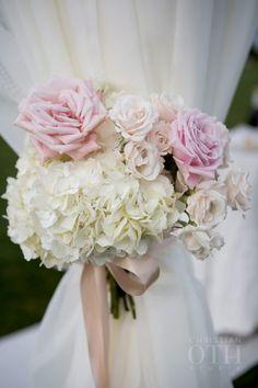Pretty hydrangea and rose wedding flowers: http://www.stylemepretty.com/rhode-island-weddings/newport-ri/2016/02/24/vintage-french-affair-wedding-at-rosecliff-mansion/   Photography: Christian Oth Studios - http://www.christianothstudio.com/