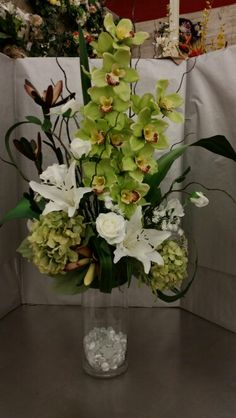 Orchids, lilies, and roses.  Designed by Stephanie Alva