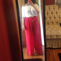 "Bright springsale Solid pleated chiffon palazzo pants with elastic waist band. Lined with shorts inside then the flowy chiffon. One size fits from (s-XL)                 Measurement while laying flat..,, waist: 13""  length: 41.5"" Pants Wide Leg"