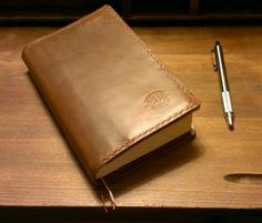 Davis Leatherworks Trade Paperback Cover in Horween Brown Chromexcel with Red Waxed Linen Thread stitching...