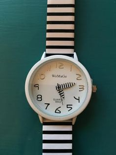 This modern black and white watch looks great with everything! - $18.99