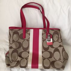 Coach purse Tan and red coach purse, tag says tan/berry color. New with tags. Will come with official Coach cloth bag for storage. No defects to cloth or leather. Coach Bags Shoulder Bags