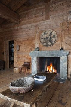 chalet verbier.  Love the fire place.  So rustic and simple. <3