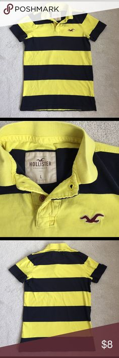 Men's Striped Polo Hollister Polo says Size Large but Hollister clothing runs small. This will definitely fit a Medium better. Yellow and Navy striped;  perfect for spring and summer! No flaws, barely worn. Hollister Shirts Polos