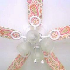Take an ordinary ceiling fan and cover it with scrapbook paper