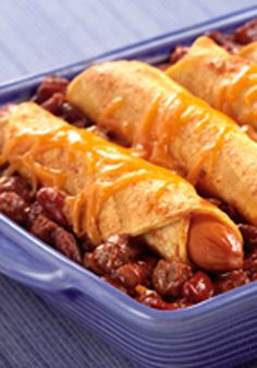 Chili Dog Casserole -- This recipe is exactly what you think it is: an easy, cheesy casserole with hot dogs, chili and beans. A classic you can now eat with a fork!