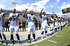 In Jacksonville, Florida, the Jaguars outside linebacker Hayes Pullard (52) and defensive end Dante Fowler (56) lifted their fists in the air in solidarity with Colin Kaepernick's protest during the national anthem before their game against the Baltimore Ravens