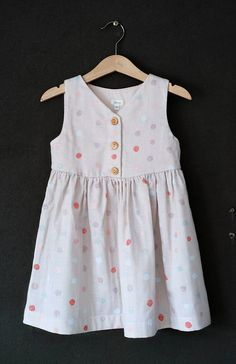 HelloTalaria on Etsy stocks irresistible little girls' clothing inspired by beautiful fabrics. The soft pastel Lauren Floral Dress shown belowusest