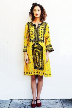 Item Description:     Yellow silk mirrored afghanni dress  with brown embroidery and mirrors though out very special and detailed dress perfect for a