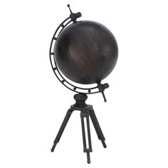 Add studious appeal to your home office or library with this metal globe decor, showcasing a matte black finish and tripod base.   P...
