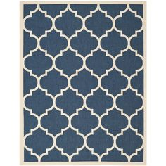 Brighten up any space with this indoor/outdoor area rug from Safavieh's Courtyard Collection. The geometric pattern in navy and white has a contemporary feel, and a durable polypropylene construction ensures that this rug will last for years.