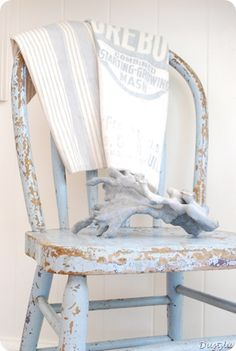 Love this pastel blue chippy little chair.