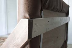 How to create your own DIY platform bed with mid-century modern flair and a do-it-yourself faux leather headboard that'll save you hundreds! Kilm Pillows, Ikea Bed Hack, Kreg Jig Projects, Mid Century Modern Bed, Simple Bed Frame, Diy Platform Bed, Leather Headboard, Ottoman Bed, Best Ikea