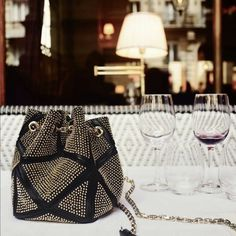 The perfect addition to any glass of #wine is an always luxurious Roger Vivier handbag. . . . . . #designer #purse #bag #totes #studs #chain #designer #highend #NYFW #FW #style #streetstyle #fashion #NYC #paris #fashionweek #wine #RogerVivier #chain #gold