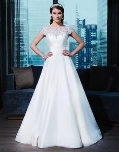 Justin Alexander signature wedding dresses style 9770 Silk dupion ball gown adorned by a Sabrina neckline.