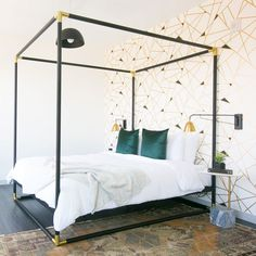 ultra-chic canopy bed + geometric statement wall