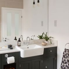 From Seventies to chic - this modern bathroom update is a sophisticated scheme worthy of a period property...and well-suited to family life too