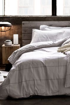 rustic wood bed plain bedding (via HM GB) - my ideal home.
