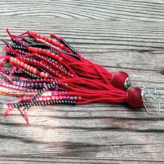 This is a red boho fringes earrings from HEraMade #bohemianfringes #bohoearrings #redearrings #bohoaccessories #bohofashion
