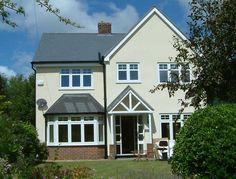 white windows, cream render, gable ended house