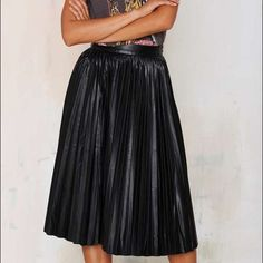 """Pleated faux leather midi skirt NWOT. Mossimo faux leather skirt. Never worn. Size: 8. Length: 24"""". Waist: 14"""" across. Mossimo Supply Co Skirts Midi"""