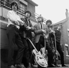 The Rolling Stones (1964).     Big Guitars!    This photo although undated was taken sometime in the first half of 1964, before the band went on their first American tour.    Almost as soon as Brian returned home he got a prototype Vox Teardrop guitar, but he is seen here holding his Anniversary Model Gretsch.    Orientation: Square  Dimensions: (inches)  Small: 12 x 12  Medium: 16 x 16  Large:: 24 x 24    Somewhere in London, Early 1964. (Mirrorpix)