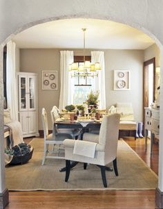 chestnut trim original to the home with walls painted cape hatteras sand  AC-34 by Benjamin Moore.  Paint color ideas for stained trim.