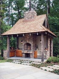 Outdoor entertaining house with fireplace, grills, etc.