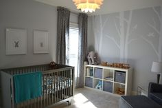Check-out this modern, yet serene nursery.  The birch tree decals are totally on-trend.  And, I spy an elephant.