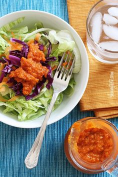 Asian Ginger Carrot Dressing Skinnytaste.com Servings: 6 • Size: 2 tbsp • Points +: 2 pts • Smart Points: 3 Calories: 82.9 • Fat: 6.8 g • Carb: 5.6 g • Fiber: 0.4 g • Protein: 0.4 g • Sugar: 4 g Sodium: 204 mg       Ingredients:   1/4 cup shredded carrots 1/4 cup minced onion  1 tbsp minced fresh ginger 1 small clove garlic  1 tbsp minced celery  3 tbsp peanut oil (or sesame oil) 3 tbsp rice vinegar 2 tbsp water 1 tbsp tomato paste 2 tsp low sodium soy sauce (use