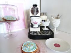 """A {silver} Nespresso maker has been on the """"to buy"""" list for quite a bit.... Alex's clever addition of milk glass merchandising just pushed it to the front of the list! <3"""