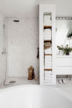 How to make the most of a small bathroom; I love the in wall storage for towels instead of a linen closet Maybe a bit too cold, but really like way to break up areas in bathroom with towel storage. Bad Inspiration, Bathroom Inspiration, Bathroom Inspo, Bathroom Ideas, Bathroom Colors, Bohemian Bathroom, Bathroom Styling, Open Showers, Walk In Showers Ideas