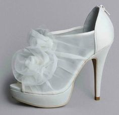This fashion-forward platform #shoe features draped organza over mesh, embellished with a flourish of raw-edge petals. White by Vera Wang, exclusively at David's Bridal Style VW370002.