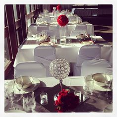 Red and white event decor.  Spectacular Settings Wedding and Event Decorating. #wedding #chaircovers #flowerballs #centerpieces