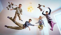 Fantastic family portrait photo idea: Everybody jump on the bed! Photo by papkefoto on flickr