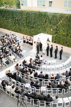 Seating in the round is a great idea when you're contending with many guests and a vast space. Above, if you were to seat this crowd traditionally, only the first few rows would be able to hear your vows easily. Seating in the round also gives a wedding a more intimate vibe, one in which friends and family are literally surrounding the happy couple.