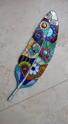 Just love the jewel-like colours on this feather. I coud imagine this adorning part of a wlled garden, with a comfy bench and some shade for a meditation focused on colour, shape and form. Mosaic feather absolutely beautiful i want this so bad Garden Art Mosaic Garden Art, Mosaic Tile Art, Mosaic Artwork, Mosaic Crafts, Mosaic Projects, Mosaic Glass, Mosaic Mirrors, Fused Glass, Stained Glass Patterns