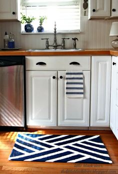 230246599673460184 Big fan of the navy/white kitchen rug, and in general the navy, white, black and wood tones.