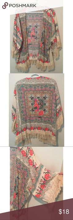 Fringed floral kimono No tag, but is most likely a one size fits all. Lightweight and loose fitting. Vibrant but subtle colors, too cute to pass up! Gives a boho look with the fringe detailing   ⭐️ cheaper on merc.app or vinted.app ❗️ Selling on different platforms and will delete if purchased from another so get it while you can! Sweaters Cardigans