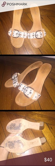 Nearly new coach cream belt buckle heels slides The ultra classic coach heels! Perfect with any summer outfit! Cream/off white and beige/brown. Size 8 B. Authentic coach sandals/heels. Genuine leather. Kardashian/Jenner style. Coach Shoes Heels