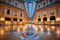 Shopping Mall, Milan, Italy. I woke up early before the city. This is an interior view of Galleria Vittorio Emanuele II shopping mall without shoppers.