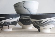 Hand made ceramic bowl in black and white marbled pattern with glossy glaze in the interior. The bowl made in slip casting technique. Each bowl gets