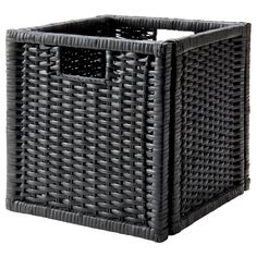 BRANÄS Basket - dark gray - IKEA - For storage in retail display shelves.  I don't see the bright blue but the gray will be good, too.  I would fill the bottom row with these for a cleaner look. You'll need 8 for the tall shelves.