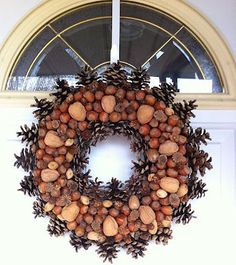 Pine cones are a common theme in fall and winter décor, but this pinecone wreath is the bees knees! Acorn Crafts, Pine Cone Crafts, Wreath Crafts, Wreath Ideas, Crafts With Acorns, Halloween Door Decorations, Christmas Decorations, Halloween Diy, Thanksgiving Decorations