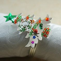 Do you still need Christmas table decor, like this Christmas tree napkin rings. Get it here.
